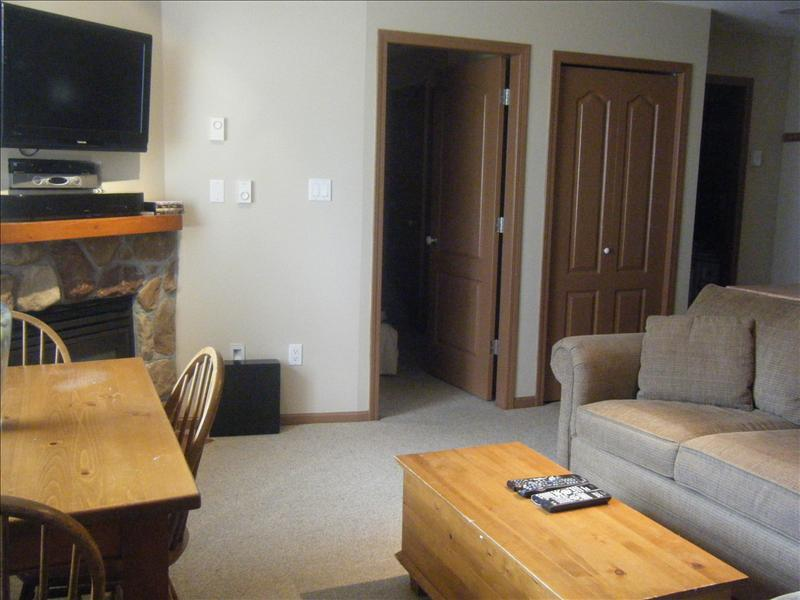 Whistler Accommodations - Living room with gas fireplace and flatscreen TV - Rentals By Owner