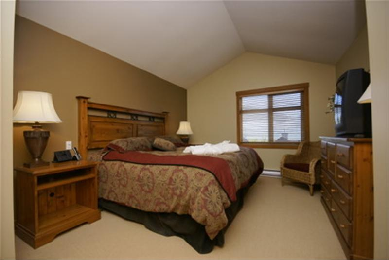 Whistler Accommodations - Master bedroom with king bed and ensuite bathroom - Rentals By Owner