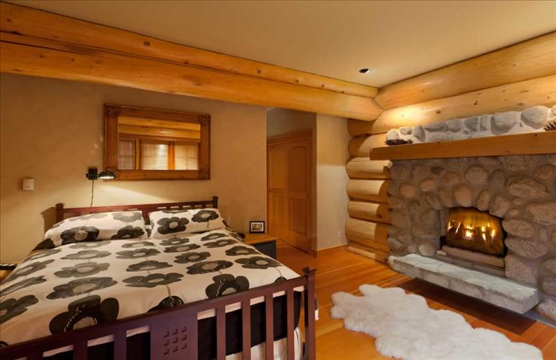 Whistler Accommodations - Whistler Log Home Bedroom with Fireplace - Rentals By Owner