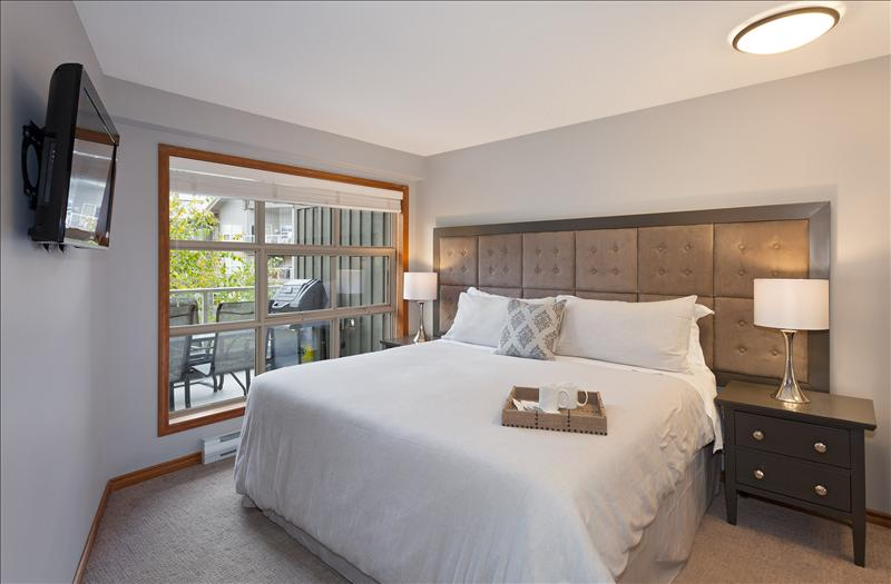 Whistler Accommodations - Master king bedroom with new custom oversized headboard and flat screen TV (can be split into twins with advance notice) - Rentals By Owner