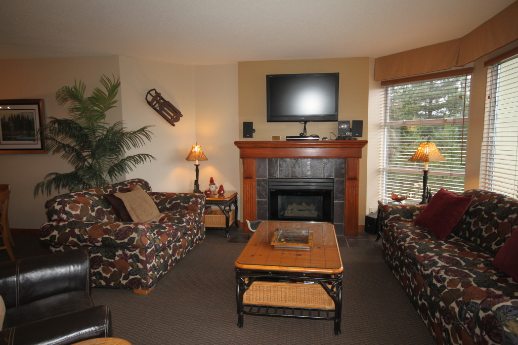 Whistler Accommodations - Living area with flat screen TV and fireplace - Rentals By Owner