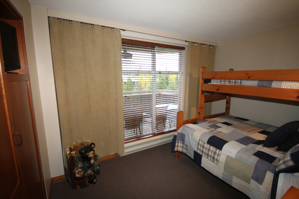 Whistler Accommodations - Second bedroom with queen and single beds - Rentals By Owner
