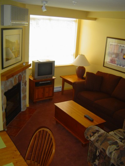 Whistler Accommodations - Living room with gas fireplace and pullout sofa - Rentals By Owner